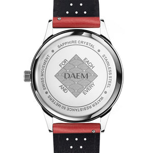 DAEM nassau black dial watch with perforated red leather strap back