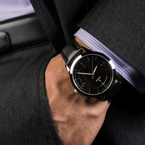 DAEM Sterling x Black leather watch on wrist