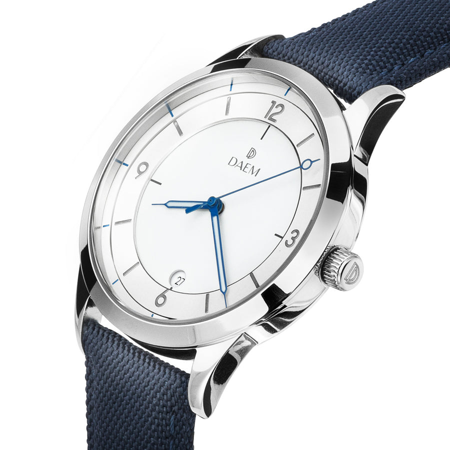 DAEM royal white dial watch with blue hands blue canvas side