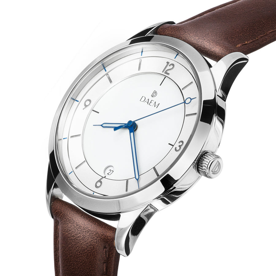 DAEM royal white dial watch with blue hands brown leather side