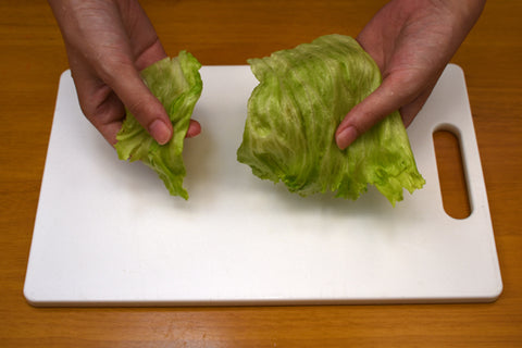 Preparing and ripping apart lettuce for ramen salad