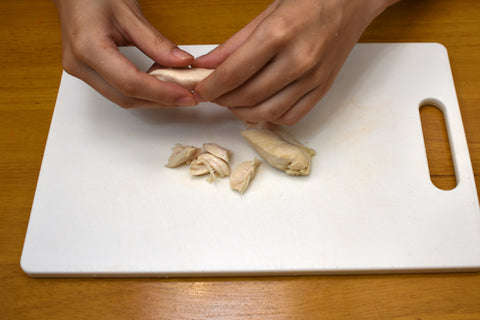 Shred chicken breast into strips by hand