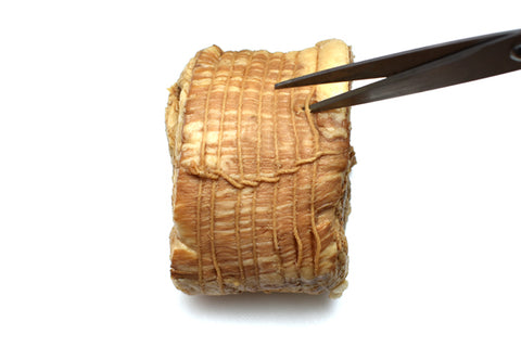Cutting up chashu for chashu recipe