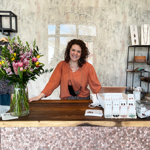 Emily at the counter of Curly Girl Boutique