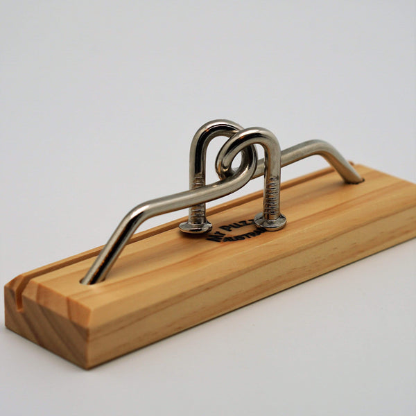 Mr. Puzzle AU Puzzles Bent Again metal nail puzzle on wood stand