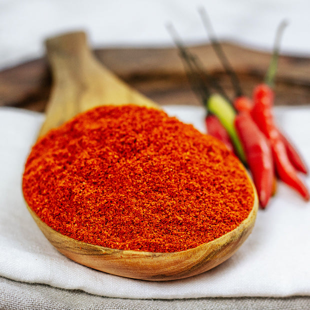 High Quality Organics Express Chili Powder in wooden spoon