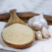 High Quality Organics Express Garlic Powder in wooden spoon