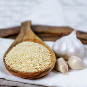 High Quality Organics Express Garlic Minced in wooden spoon