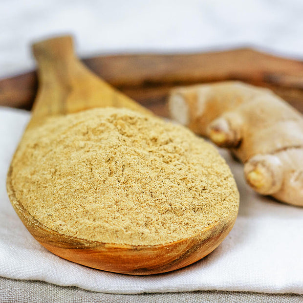 High Quality Organics Express Ginger Ground in wooden spoon