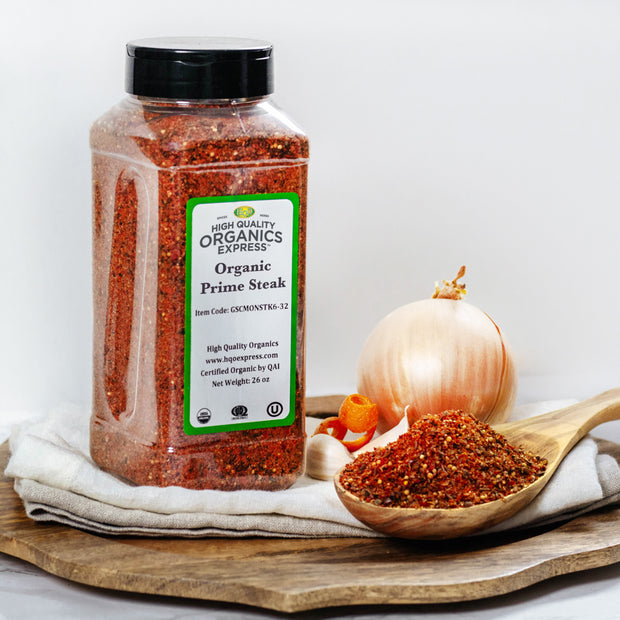 High Quality Organics Express Prime Steak Seasoning with spoon on table
