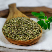 High Quality Organics Express Oregano in wooden spoon