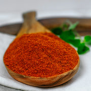 High Quality Organics Express Paprika in wooden spoon