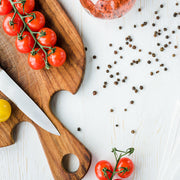 black pepper tomatos on cutting board