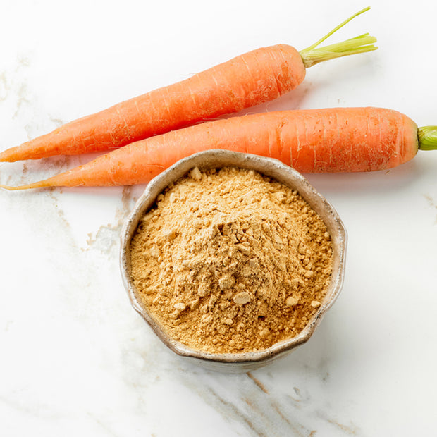 High Quality Organics Express Carrot Powder in bowl with carrots