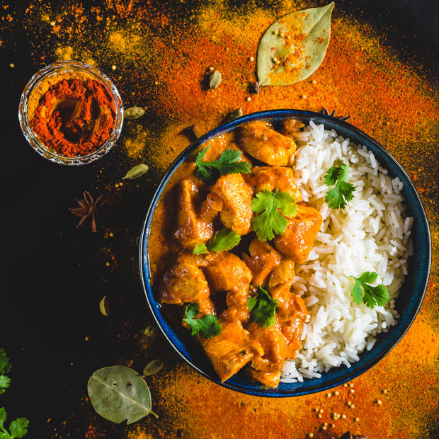 High Quality Organics Express Garam Masala chicken over rice in bowl