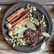 High Quality Organics Express Garam Masala dried ingredients in a bowl, cinnamon, nutmeg, bay leaf, cardamom, star anise, cloves