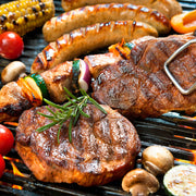 High Quality Organics Express Mesquite Steak with sausage and kebab on grill