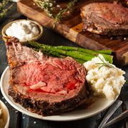 High Quality Organics Express Prime Rib Seasoning with sliced meat on plate with mashed potatoes and asparagus