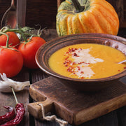 High Quality Organics Express Red Chili Pepper crushed over pumpkin soup