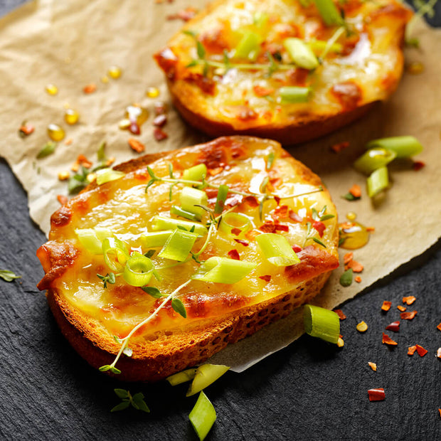 High Quality Organics Express Red Chili Pepper over cheesy toast and green onions