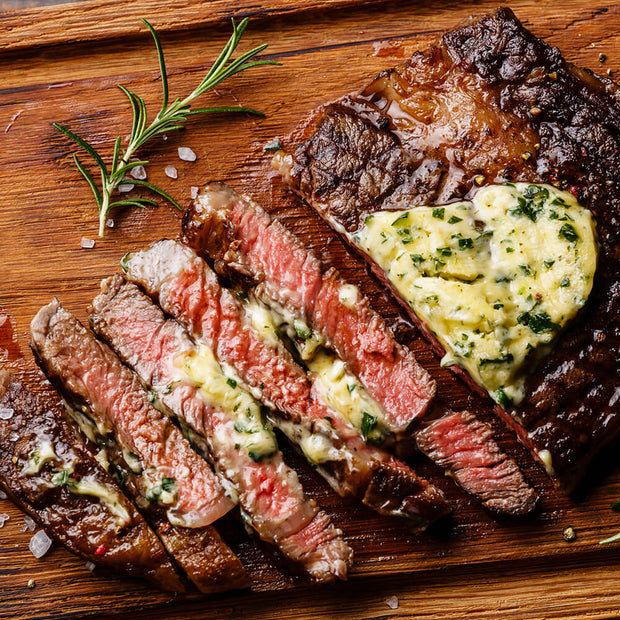 High Quality Organics Express Steak Seasoning on sliced rare steak with herb butter
