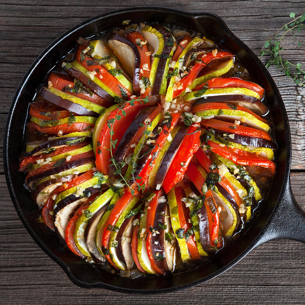 High Quality Organics Express vegetable seasoning on ratatouille