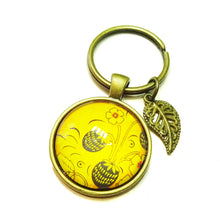 Load image into Gallery viewer, Yellow Floral Glass Cameo Antique Brass Keyring / Key Fob
