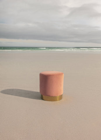 Theodore Afrika - Still Symmetry 07 - Print of a peach coloured ottoman on the beach.
