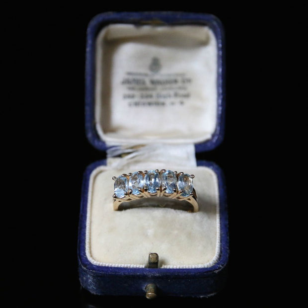 BLUE TOPAZ FIVE STONE RING 9CT GOLD