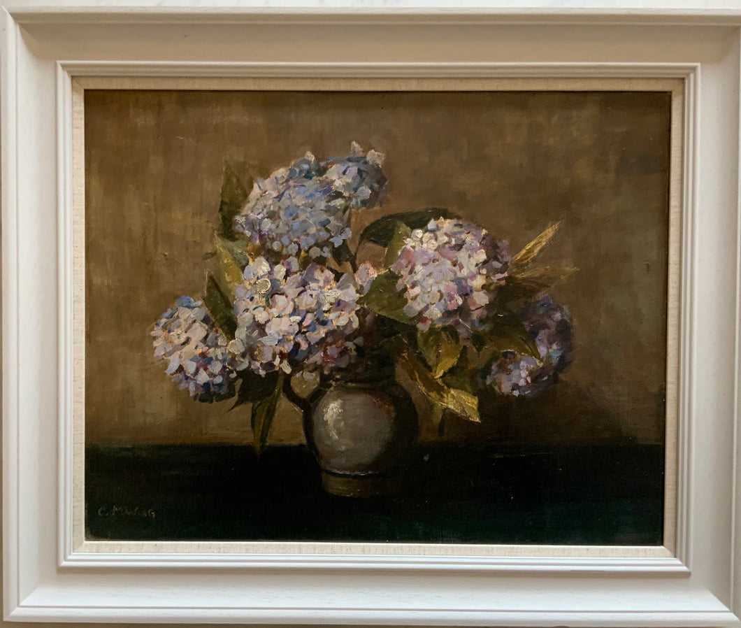 Oil painting on board: Blue hydrangeas in a grey jug (C.M. Wagg)