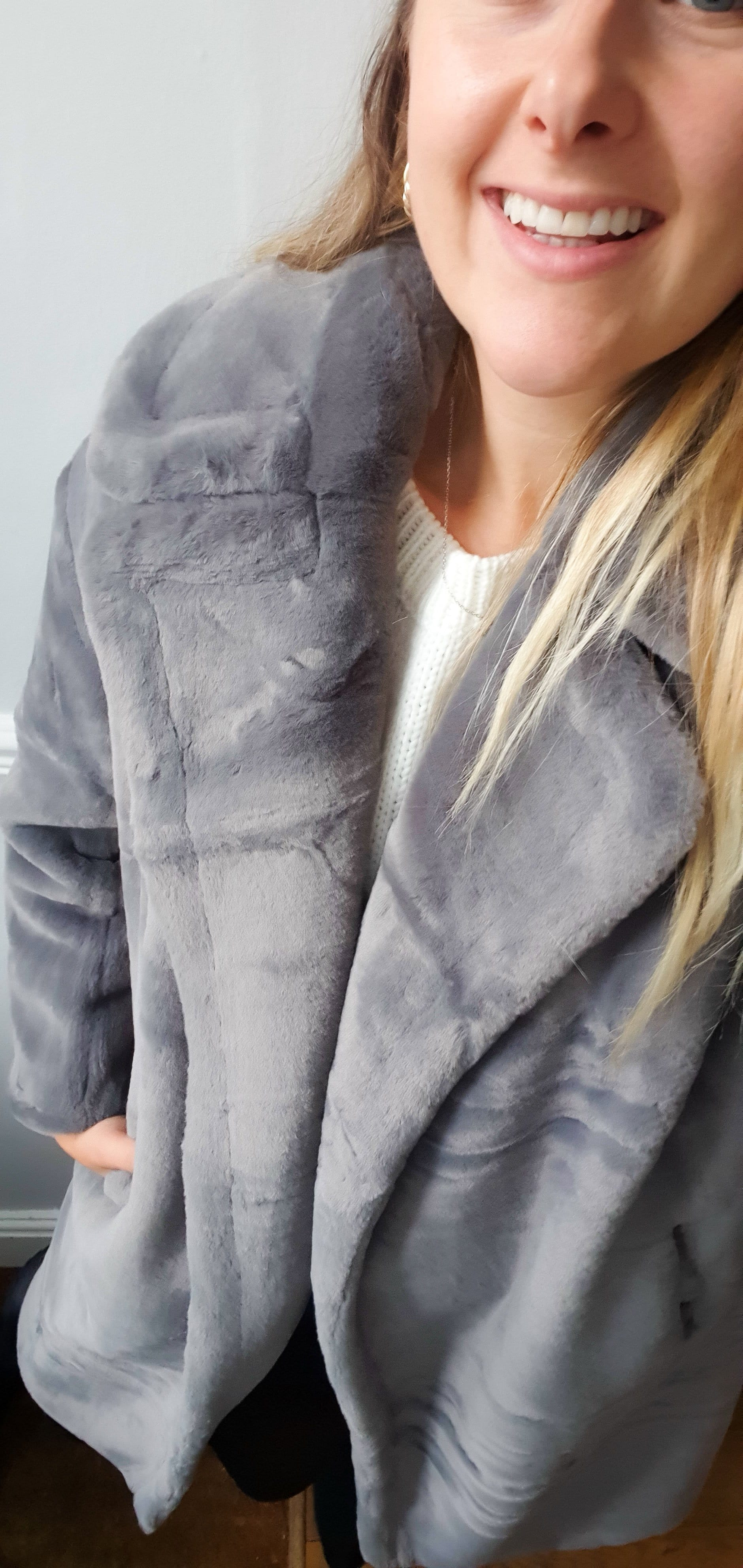 The long faux fur coat