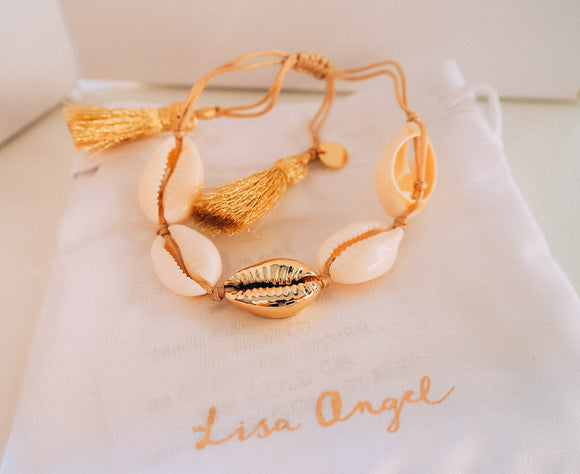 Gold shell bracelet with tassel