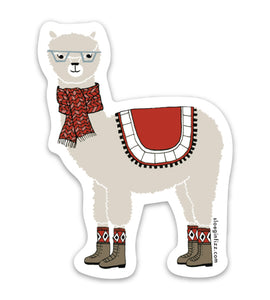 Vinyl sticker with a hand-drawn illustration of an alpaca wearing glasses, a scarf, argyle socks, boots and a decorative blanket