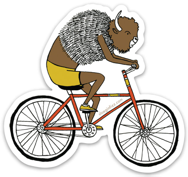 A sticker with a hand-drawn illustration of a bison riding a red bicycle wearing yellow cycling shorts and yellow sneakers.