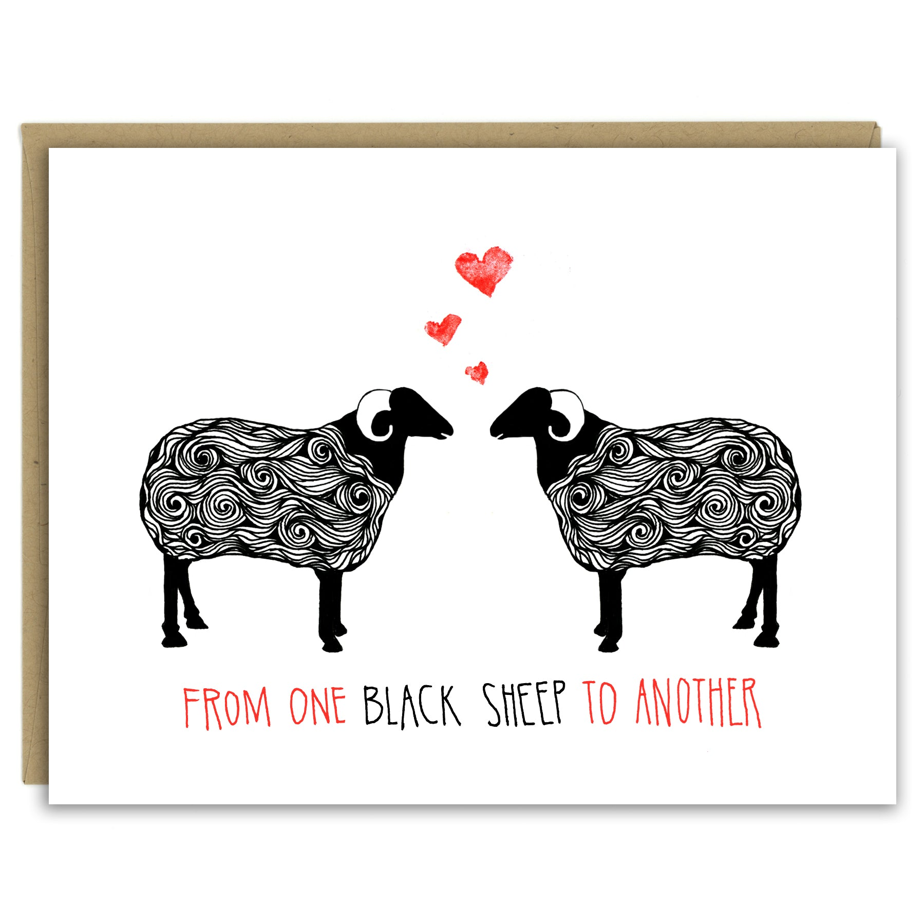 "A greeting card with a hand-drawn ink illustration of a pair of black and white sheep with horns facing each other with three hearts over their heads. A hand-lettered message reads, ""From one black sheep to another."" Shown with a Kraft paper envelope on a white background."