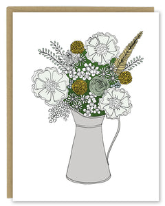 A greeting card showing a hand-drawn illustration of a bouquet of flowers in greys, greens and golds in a silver metal pitcher. Shown with a Kraft paper envelope on  a white background.