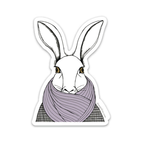 A sticker with a hand-drawn ink illustration of a white rabbit bundled up in a tweed overcoat and purple scarf covering its mouth. Shown on a white background.