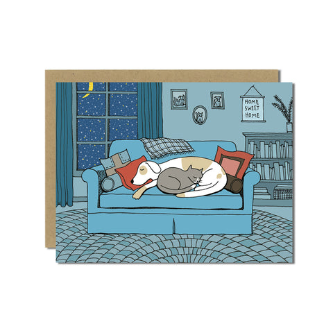 Dog and Cat Snuggle on a Winter's Eve Greeting Card