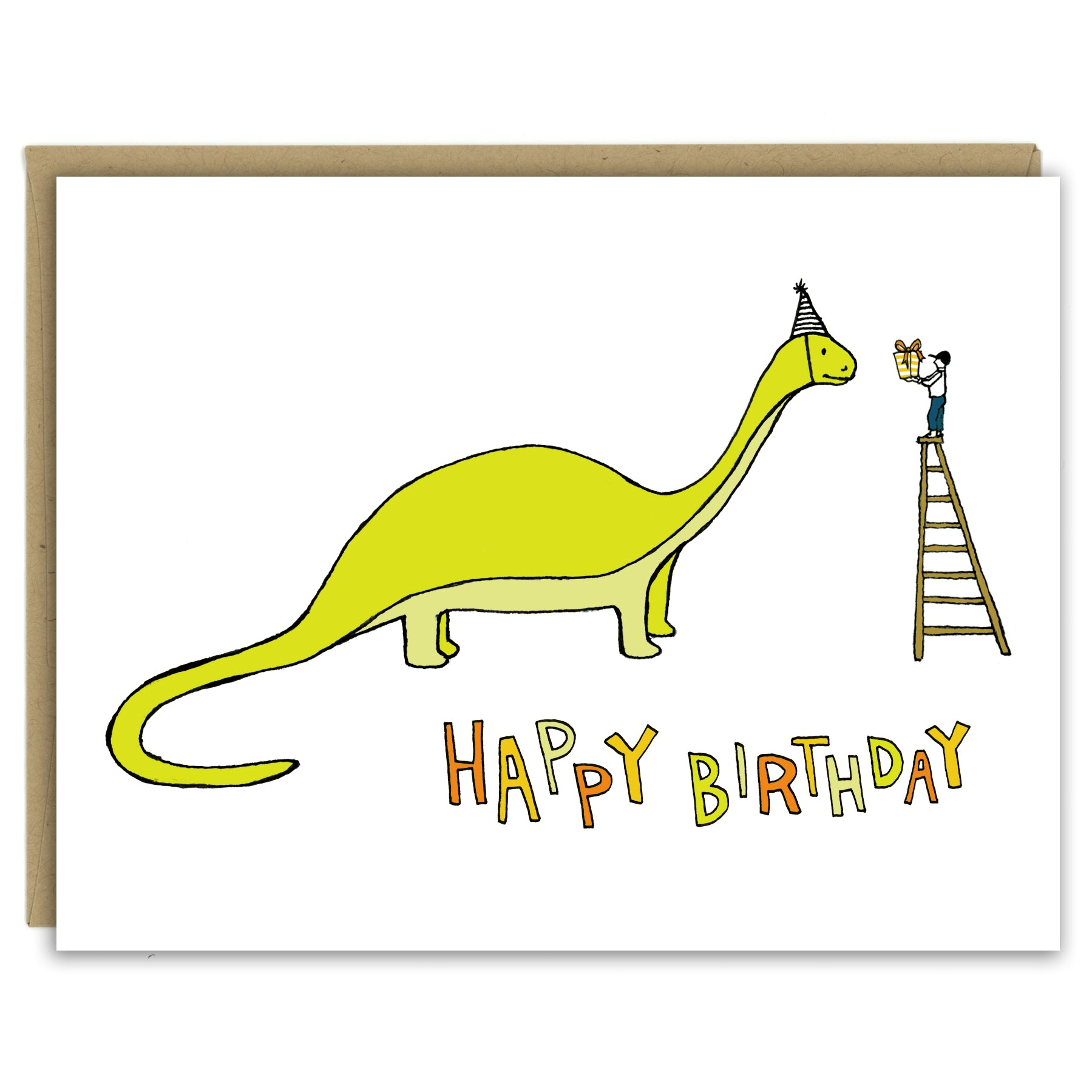 "A greeting card showing a hand-drawn illustration of a green brontosaurus wearing a party hat. A small boy stands on top of a ladder handing the dinosaur a wrapped birthday gift. A hand-lettered message reads, ""Happy Birthday."" Shown with a Kraft paper envelope on a white background."