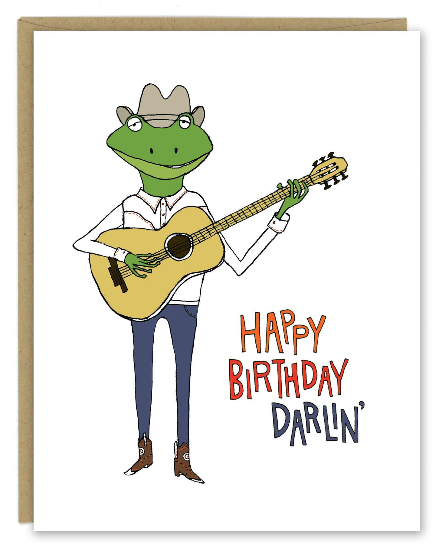 A greeting card showing a hand-drawn illustration of a frog playing a guitar, wearing cowboy boots, a cowboy hat, jeans and a white Western shirt. Shown with a Kraft paper envelope on a white background.