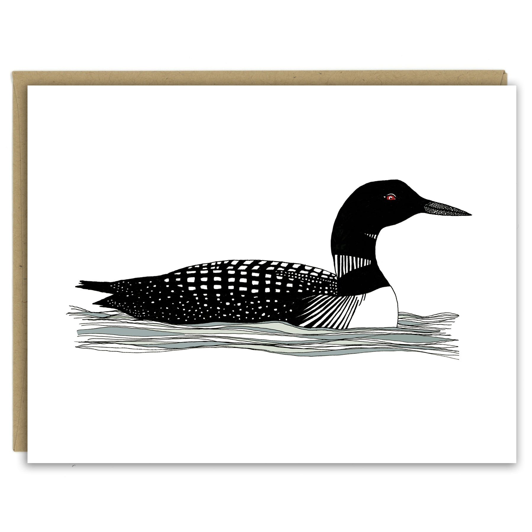 A greeting card showing a hand-drawn illustration of a black and white loon with its signature red eye, floating gently on the waves. Shown with a Kraft paper envelope on a white background.