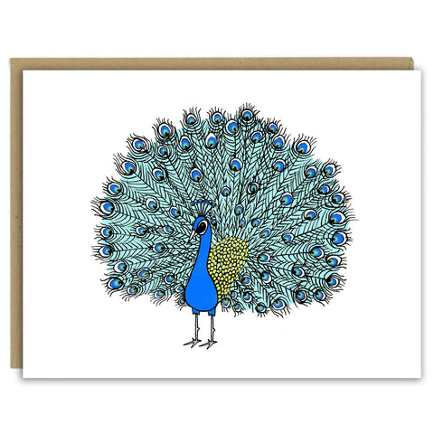 A greeting card with a hand-drawn ink illustration of peacock with its showy tail feathers in full plume. Shown with a Kraft paper envelope on a white background.