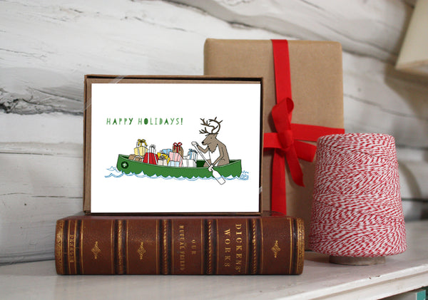 Reindeer in a Canoe of Gifts Holiday Card — Boxed Sets or Singles