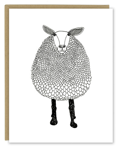 A greeting card with a hand-drawn black and white ink illustration of a sheep. Shown with a Kraft paper envelope on a white background.