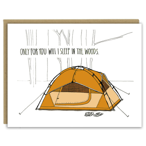 "A greeting card showing a hand-drawn illustration of an orange tent in the woods with two pairs of shoes out front. The card has a hand-lettered message reading, ""Only for you will I sleep in the woods.""  Shown with a Kraft paper envelope on a white background."