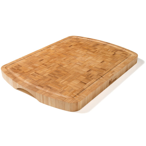 A beautiful handcrafted extra large bamboo chopping board made from end grain bamboo. Each piece is unique with bamboo strips set against one another creating a quite gorgeous pattern. Rounded finger grips on the ends allow you to easily pick it up. A juice groove runs around the edge to collect liquids preventing them from spilling on to your kitchen counter and keeping surfaces clean for you.