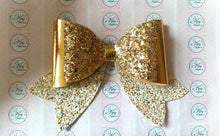 Load image into Gallery viewer, Gold glitter and leatherette tail down bow