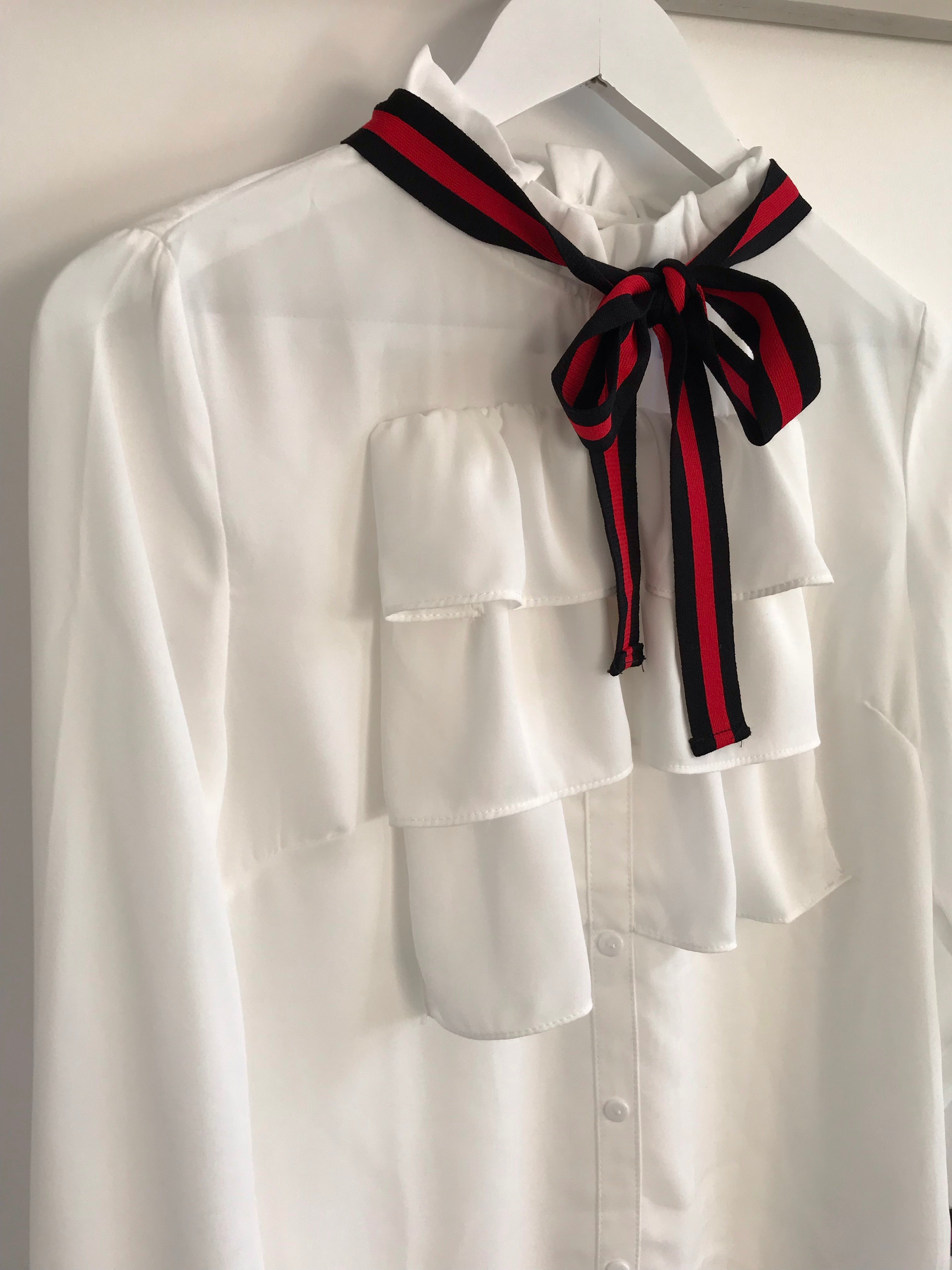 White Blouse with Red Neck Tie