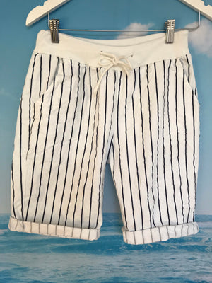 White shorts with blue stripe