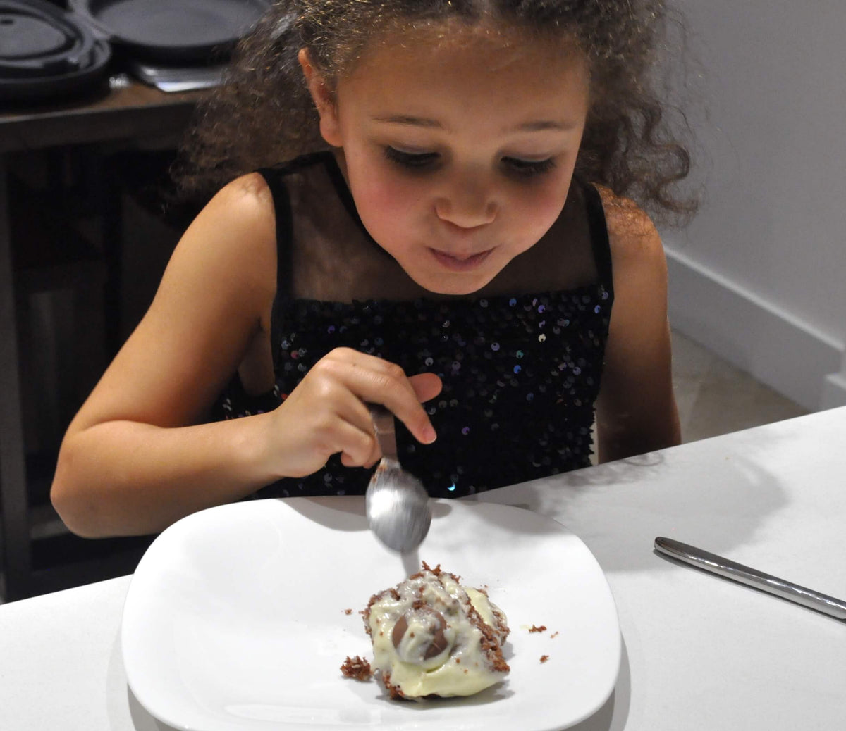 Girl eating a soulcialize's gluten free cake